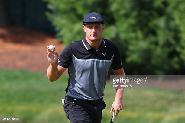 Bryson DeChambeau of the United States acknowledges the gallery after making a par on the eighth green during the second round of the Travelers...