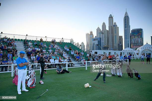 Bryson DeChambeau of the United States and Matthew Fitzpatrick of England demonstrate their skills during the 'Stars and Stripes' Clinic after the...