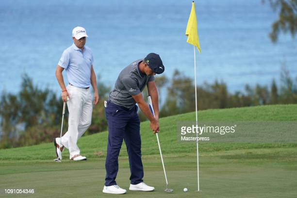 Bryson DeChambeau of the United States attempts a putt on the 12th green during the final round of the Sentry Tournament of Champions at the...