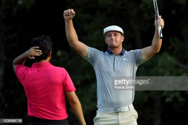 Bryson DeChambeau of the United States celebrates in front of Abraham Ancer after making a par on the 18th green to win the Dell Technologies...