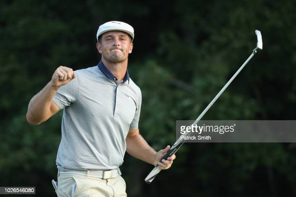 Bryson DeChambeau of the United States celebrates making a par on the 18th green to win the Dell Technologies Championship at TPC Boston on September...