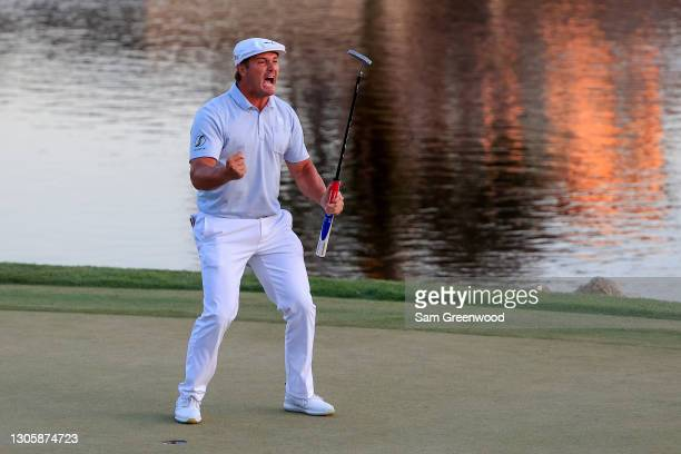 Bryson DeChambeau of the United States celebrates making his putt on the 18th green to win during the final round of the Arnold Palmer Invitational...