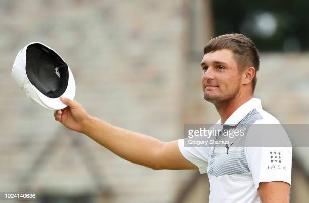 Bryson DeChambeau of the United States celebrates on the 18th green after winning during the final round of The Northern Trust on August 26 2018 at...