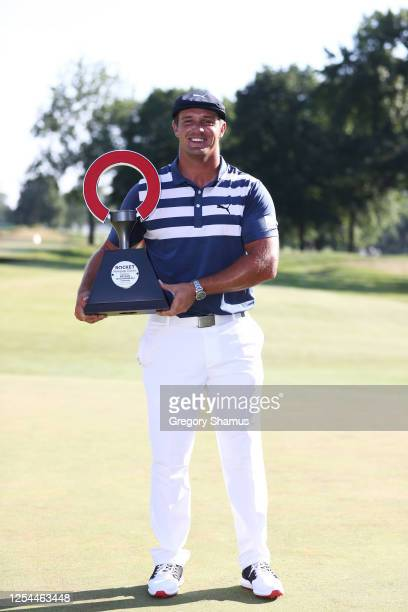Bryson DeChambeau of the United States celebrates with the trophy after winning during the final round of the Rocket Mortgage Classic on July 05,...
