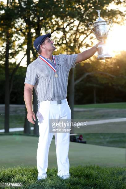 Bryson DeChambeau of the United States celebrates with the championship trophy after winning the 120th U.S. Open Championship on September 20, 2020...
