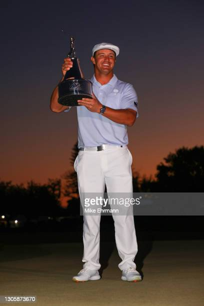 Bryson DeChambeau of the United States celebrates with the trophy after winning the final round of the Arnold Palmer Invitational Presented by...