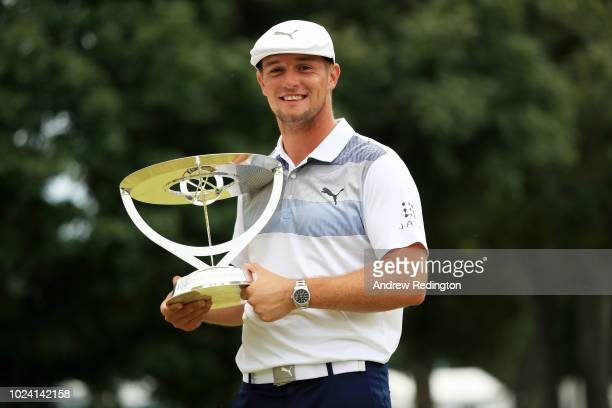 Bryson DeChambeau of the United States celebrates with the winner's trophy after the final round of The Northern Trust on August 26 2018 at the...