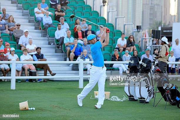 Bryson DeChambeau of the United States demonstrates his skills during the 'Stars and Stripes' Clinic after the first round of the 2016 Omega Dubai...