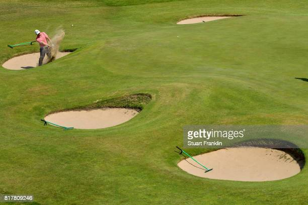 Bryson DeChambeau of the United States hits a bunker shot during a practice round prior to the 146th Open Championship at Royal Birkdale on July 18...