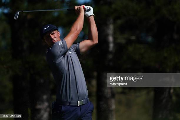 Bryson DeChambeau of the United States hits a tee shot on the 2nd hole during the final round of the Sentry Tournament of Champions at the Plantation...
