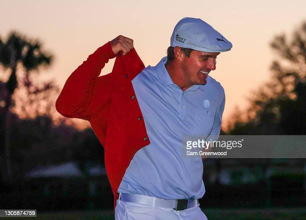 Bryson DeChambeau of the United States is awarded a replica Arnold Palmer sweater after winning the final round of the Arnold Palmer Invitational...