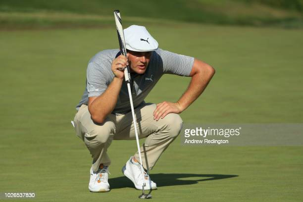 Bryson DeChambeau of the United States lines up a putt on the 11th green during the final round of the Dell Technologies Championship at TPC Boston...