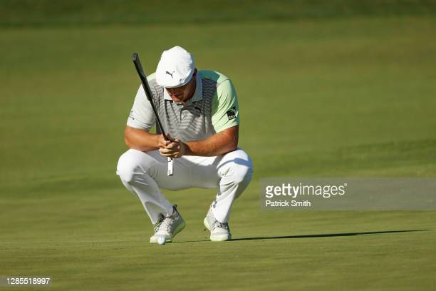 Bryson DeChambeau of the United States lines up a putt on the second green during the second round of the Masters at Augusta National Golf Club on...
