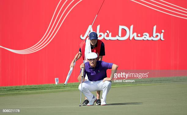 Bryson Dechambeau of The United States lines up an eagle putt at the par 5, 18th hole during the first round of the 2016 Abu Dhabi HSBC Golf...