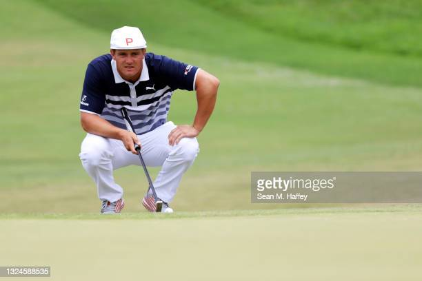 Bryson DeChambeau of the United States lines up his putt on the second green during the final round of the 2021 U.S. Open at Torrey Pines Golf Course...