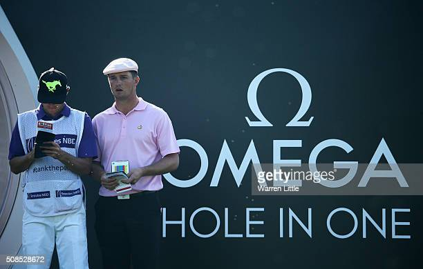 Bryson DeChambeau of the United States looks on from the 7th tee with his caddie during the second round of the Omega Dubai Desert Classic at the...