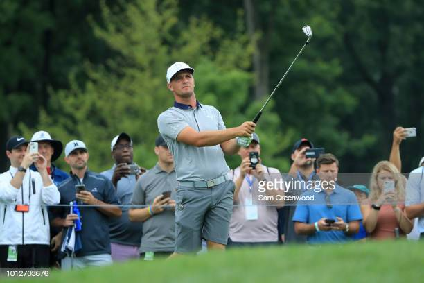 Bryson DeChambeau of the United States plays a shot as fans look on during a practice round prior to the 2018 PGA Championship at Bellerive Country...