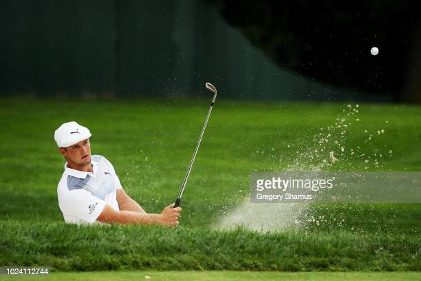 Bryson DeChambeau of the United States plays a shot from a bunker on the tenth hole during the final round of The Northern Trust on August 26 2018 at...
