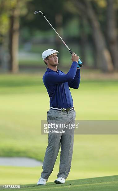Bryson DeChambeau of the United States plays an approach shot on the 10th hole during day one of the 2015 Australian Open at The Australian Golf Club...