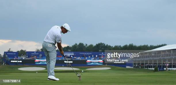 Bryson Dechambeau of the United States plays his second shot from the 18th fairway during day three of the Porsche European Open at Green Eagle Golf...