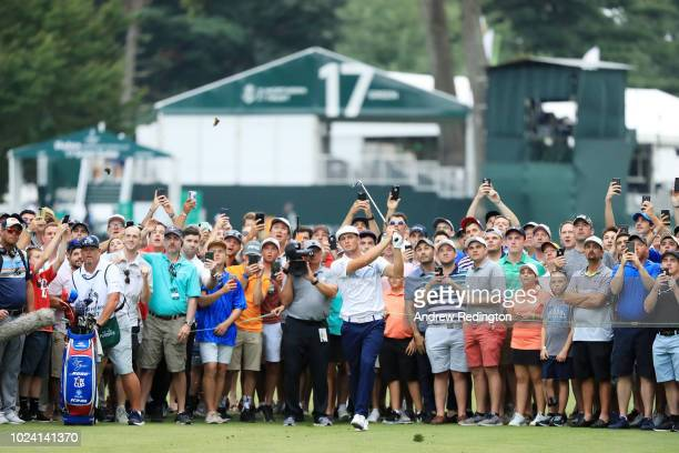 Bryson DeChambeau of the United States plays his second shot on the 18th hole during the final round of The Northern Trust on August 26 2018 at the...