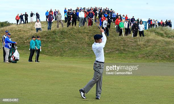 Bryson DeChambeau of the United States plays his second shot on the 8th hole in his match with Robby Shelton against Gavin Moynihan and Jack Hume of...