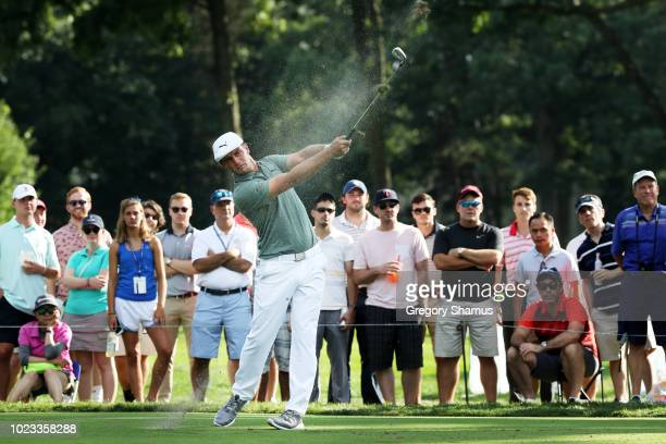 Bryson DeChambeau of the United States plays his shot from the 15th tee during the third round of The Northern Trust on August 25 2018 at the...