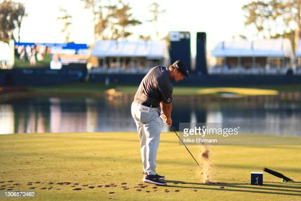 Bryson DeChambeau of the United States plays his shot from the 17th tee during the first round of THE PLAYERS Championship on THE PLAYERS Stadium...