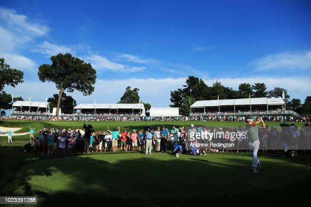 Bryson DeChambeau of the United States plays his shot from the 18th tee during the third round of The Northern Trust on August 25 2018 at the...