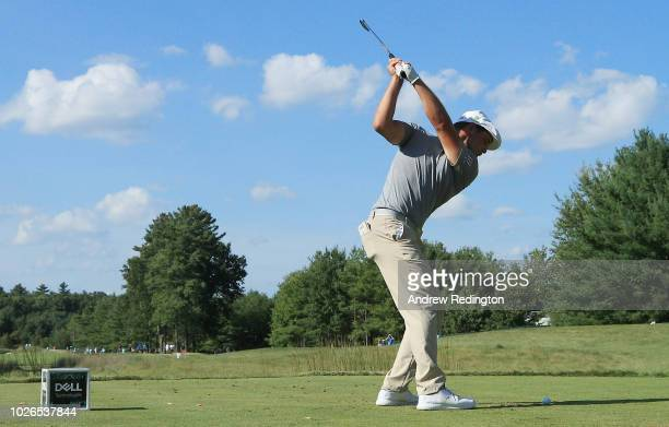 Bryson DeChambeau of the United States plays his shot from the tenth tee during the final round of the Dell Technologies Championship at TPC Boston...