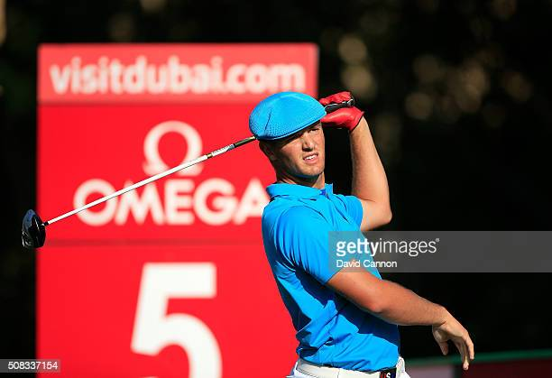 Bryson DeChambeau of the United States plays his tee shot at the par 4 fifth hole during the first round of the 2016 Omega Dubai Desert Classic on...