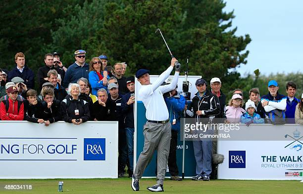 Bryson DeChambeau of the United States plays his tee shot on the 9th hole in his match with Robby Shelton against Gavin Moynihan and Jack Hume of the...