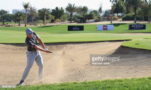 Bryson Dechambeau of the United States plays out of a bunker on the 16th hole during day one of the Abu Dhabi HSBC Golf Championship at Abu Dhabi...
