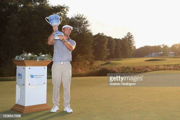 Bryson DeChambeau of the United States poses with the trophy after winning the Dell Technologies Championship at TPC Boston on September 3, 2018 in...