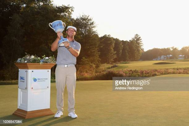 Bryson DeChambeau of the United States poses with the trophy after winning the Dell Technologies Championship at TPC Boston on September 3 2018 in...
