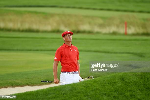 Bryson DeChambeau of the United States prepares to play his third shot on the 18th hole during the first round of the US Open at Oakmont Country Club...