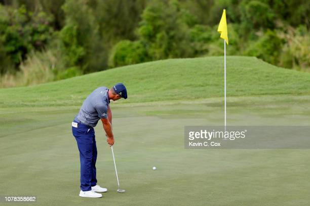 Bryson DeChambeau of the United States putts on the 12th green during the final round of the Sentry Tournament of Champions at the Plantation Course...