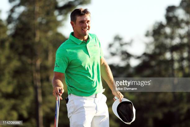 Bryson DeChambeau of the United States reacts on the 18th green during the first round of the Masters at Augusta National Golf Club on April 11 2019...