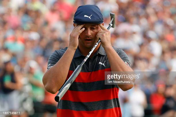Bryson DeChambeau of the United States reacts to a missed birdie attempt during a playoff on the 18th green during the final round of the BMW...
