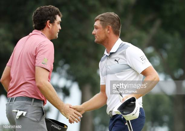 Bryson DeChambeau of the United States shakes hands with Keegan Bradley of the United States after finishing on the 18th green during the final round...