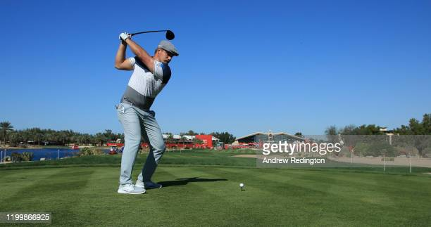 Bryson DeChambeau of The United States tees off on the ninth during Day One of the Abu Dhabi HSBC Championship at Abu Dhabi Golf Club on January 16,...