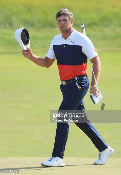 Bryson DeChambeau of the United States waves on the 18th green during the final round of the 2018 US Open at Shinnecock Hills Golf Club on June 17...