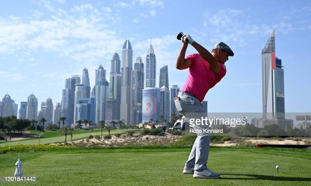 Bryson DeChambeau of the USA tees off on the par four 8th hole during the third round of the Omega Dubai Desert Classic at Emirates Golf Club on...