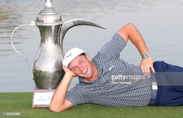 Bryson DeChambeau of the USA with the winners trophy after the final round of the Omega Dubai Desert Classic at Emirates Golf Club on January 27 2019...
