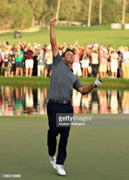 Bryson Dechambeau of United States celebrates winning the tournament on hole eighteen during Day Four of the Omega Dubai Desert Classic at Emirates...