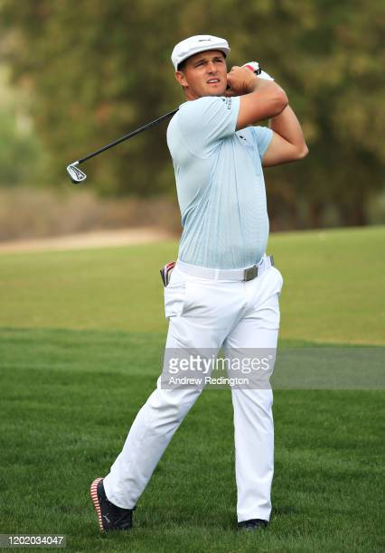 Bryson Dechambeau of United States plays his second shot on the third hole during Day Four of the Omega Dubai Desert Classic at Emirates Golf Club on...