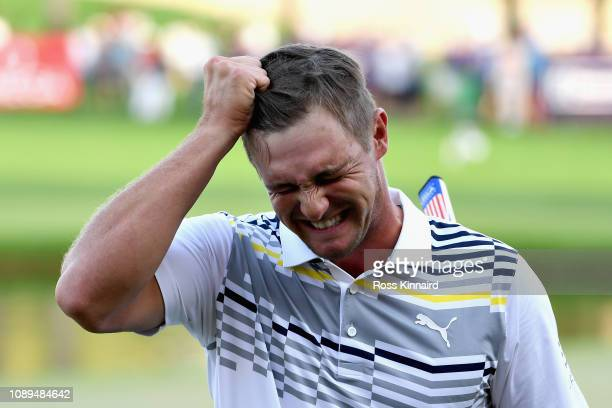 Bryson Dechambeau of United States reacts to his putt on hole eighteen during Day Three of the Omega Dubai Desert Classic at Emirates Golf Club on...