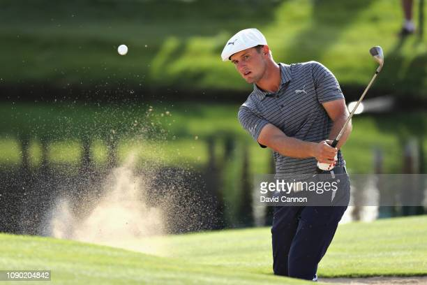 Bryson Dechambeau of United States takes his third shot on hole thirteen from a bunker during Day Four of the Omega Dubai Desert Classic at Emirates...
