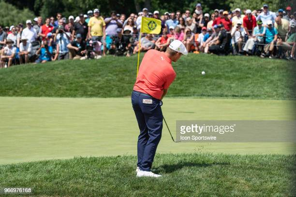 Bryson DeChambeau plays a chip shot to the 18th green during the first playoff hole in the final round of the Memorial Tournament at Muirfield...