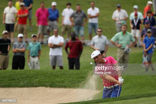 Bryson DeChambeau plays a shot from a bunker on the 17th hole during the second round of the Quicken Loans National at Congressional Country Club on...